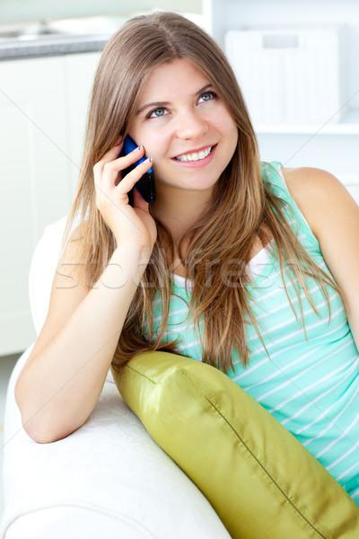 Pozytywny kobieta mówić telefonu posiedzenia sofa Zdjęcia stock © wavebreak_media