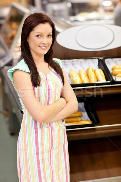 Self-assured female cook smiling at the camera in front of her bakery at work Stock photo © wavebreak_media
