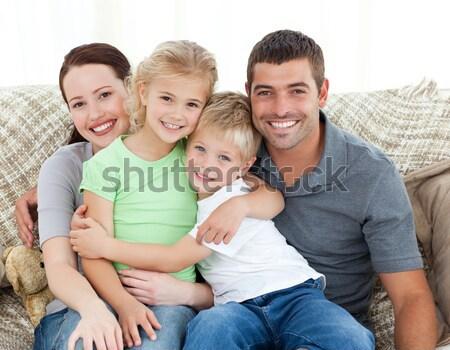 Boldog család ül kanapé otthon nő gyerekek Stock fotó © wavebreak_media