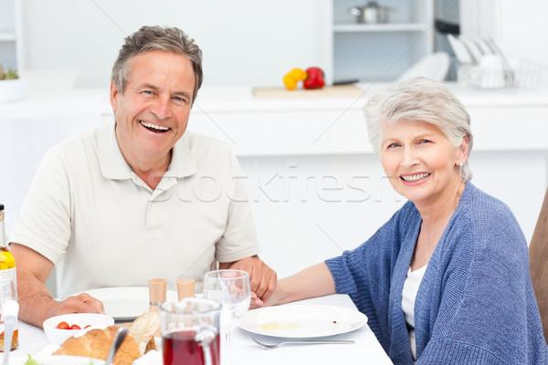 Jubilado Pareja comer cocina casa sonrisa Foto stock © wavebreak_media