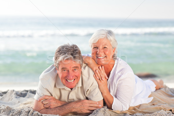 Elderly couple lying down on the beach Stock photo © wavebreak_media