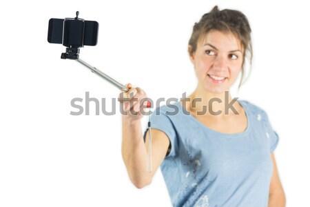 Boa aparência mulher telefone móvel em pé branco Foto stock © wavebreak_media
