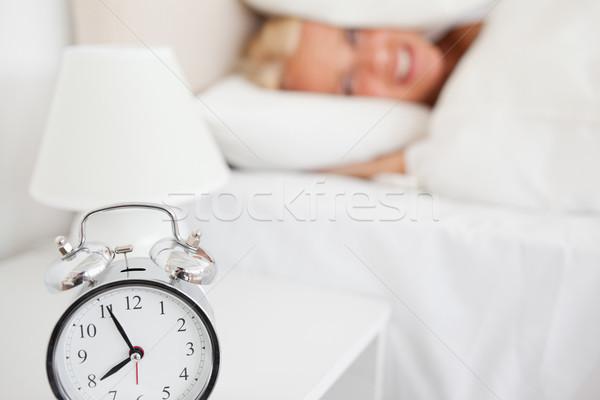 женщину голову подушкой спальня рук кровать Сток-фото © wavebreak_media