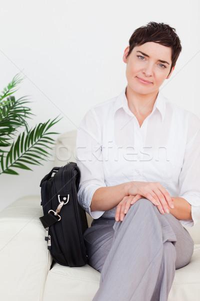 Işkadını çanta bekleme odası kadın çiçek para Stok fotoğraf © wavebreak_media
