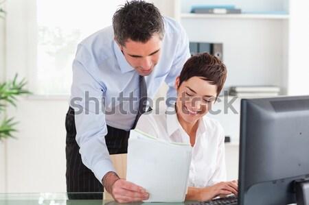 Férfi készít telefon néz kollégák képernyő Stock fotó © wavebreak_media