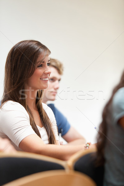Portrait of a smiling student sitting in an amphitheater Stock photo © wavebreak_media
