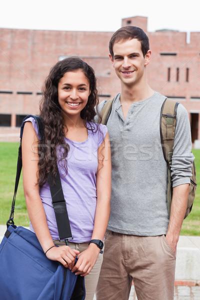 Portrait of a smiling student couple posing outside building Stock photo © wavebreak_media