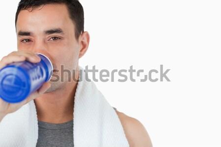 Genç erkek yudum su eğitim Stok fotoğraf © wavebreak_media