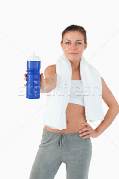Sip of water being offered by young woman against a white background Stock photo © wavebreak_media