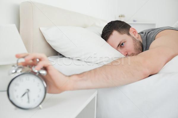 Alszik vonzó férfi ébresztőóra hálószoba üzlet Stock fotó © wavebreak_media