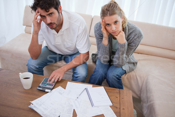 Worried couple doing their accounting in their living room Stock photo © wavebreak_media