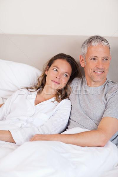 портрет счастливым пару кровать камеры Сток-фото © wavebreak_media