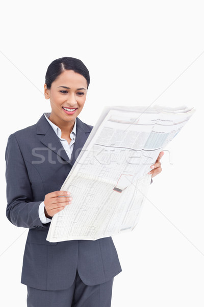 Close up of smiling saleswoman reading the news paper against a white background Stock photo © wavebreak_media
