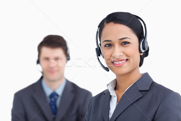 Close up of smiling call center agents against a white background Stock photo © wavebreak_media