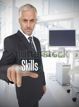 Smiling mature tradesman presenting screen of his tablet computer against a white background Stock photo © wavebreak_media