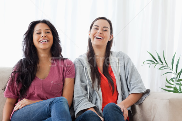 Zwei Frauen aussehen gerade vor sitzen neben Stock foto © wavebreak_media