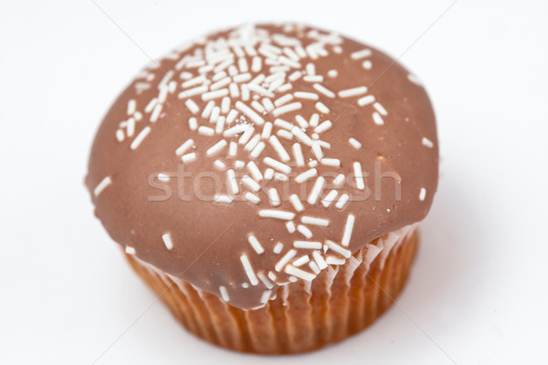 Brown cupcake against a white background Stock photo © wavebreak_media
