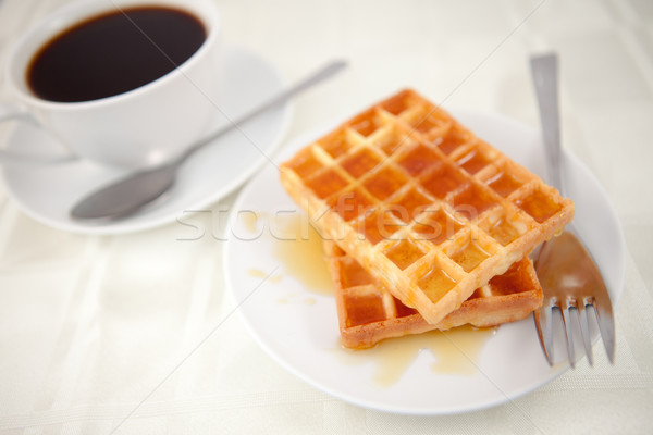 Waffles placed near a coffee cup on a table Stock photo © wavebreak_media