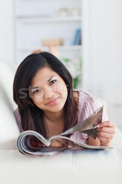 Kadın kanepe dergi oturma odası Stok fotoğraf © wavebreak_media