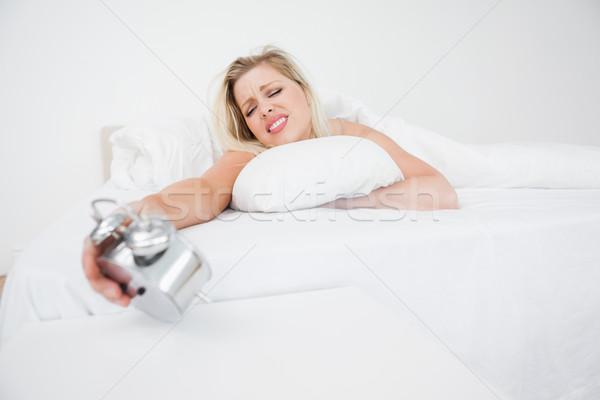 動揺 女性 見える 目覚まし時計 ベッド 時間 ストックフォト © wavebreak_media