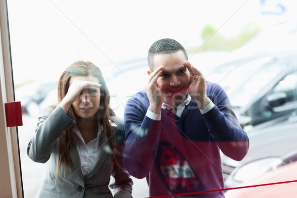 People looking through a shopwindow of a dealership Stock photo © wavebreak_media