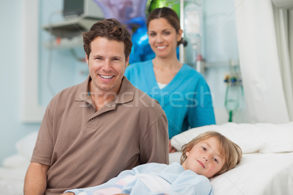 Child lying on a medical bed in hospital ward Stock photo © wavebreak_media