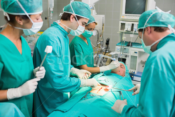 Concentrated surgeons in an operating theatre Stock photo © wavebreak_media