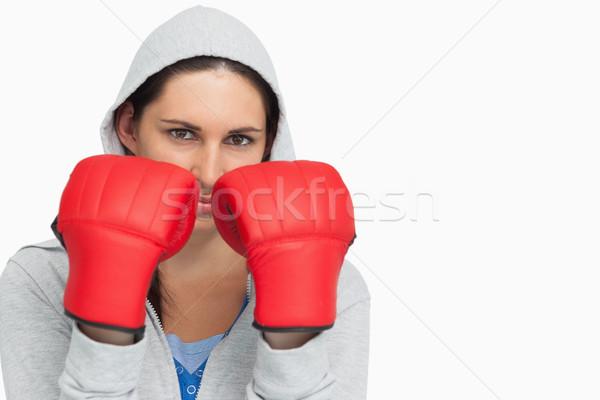 Bruna donna indossare guantoni da boxe bianco Foto d'archivio © wavebreak_media