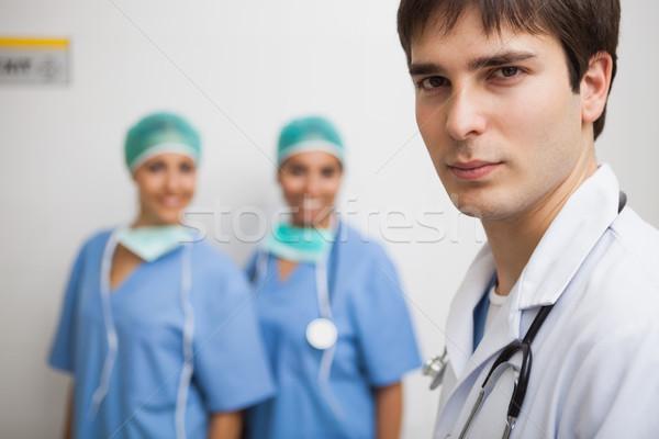 удовлетворенный врач лабораторный халат два улыбаясь Сток-фото © wavebreak_media