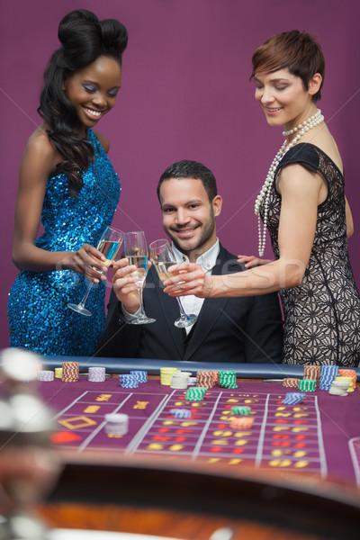 Homme femmes verres casino femme argent Photo stock © wavebreak_media