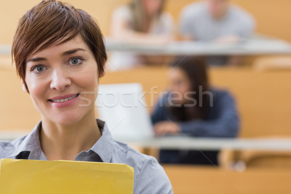 Nauczyciel stałego wykład sali uśmiechnięty uśmiech Zdjęcia stock © wavebreak_media
