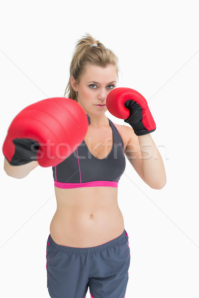 Woman standing in boxing gear ready to punch Stock photo © wavebreak_media