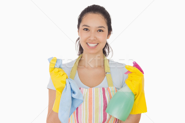 Smiling woman holding cloth and spray bottle in apron and rubber gloves Stock photo © wavebreak_media