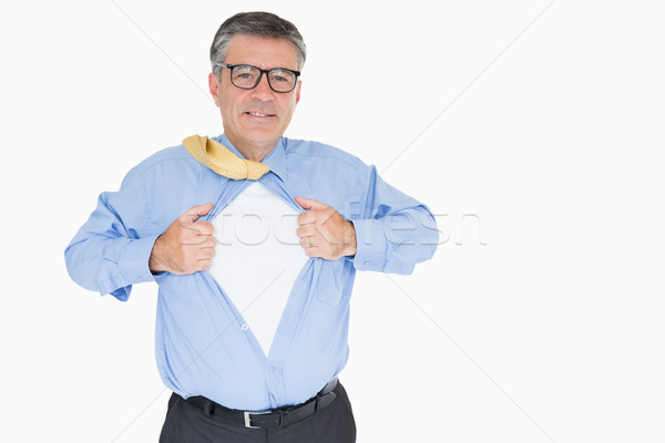 Happy man with glasses is pulling his shirt with his hands like a superhero Stock photo © wavebreak_media