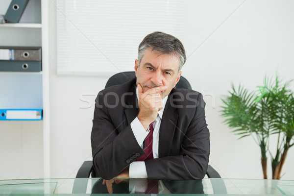Sitting businessman looking thoughtfully in his office Stock photo © wavebreak_media