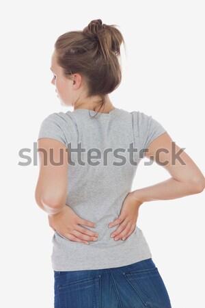 Mulher jovem sofrimento dor nas costas branco dor Foto stock © wavebreak_media