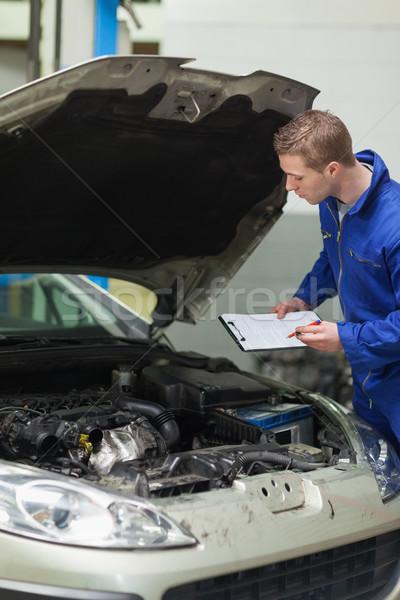 Mechanic checking car engine Stock photo © wavebreak_media
