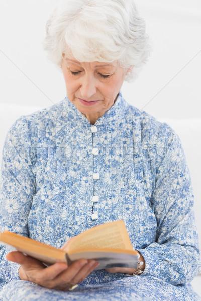 Elderly focused woman reading a old novel Stock photo © wavebreak_media