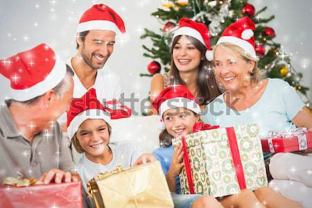 Happy family at christmas swapping gifts Stock photo © wavebreak_media