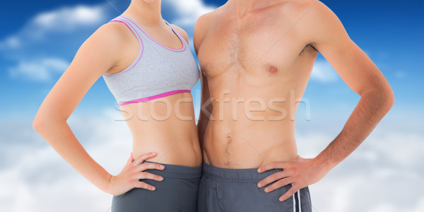 Composite image of mid section of a fit young couple Stock photo © wavebreak_media