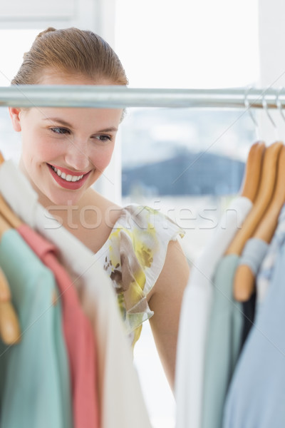 Beautiful female customer selecting clothes at store Stock photo © wavebreak_media