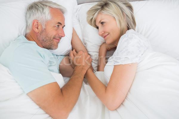 любящий зрелый человек женщину кровать домой дома Сток-фото © wavebreak_media