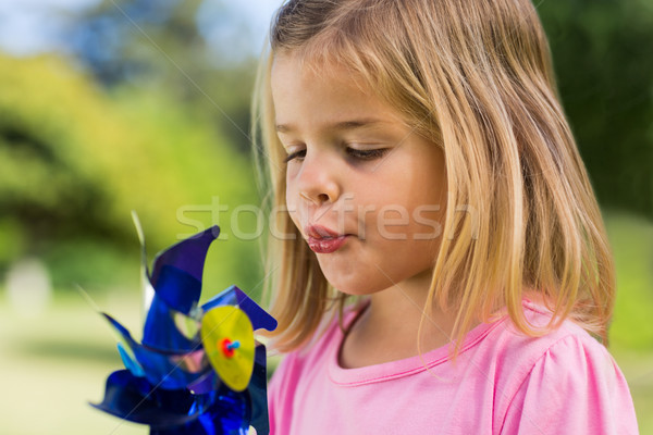 Cute girl blowing pinwheel at park Stock photo © wavebreak_media