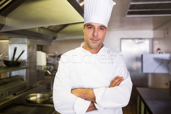 Male cook with arms crossed standing in kitchen Stock photo © wavebreak_media