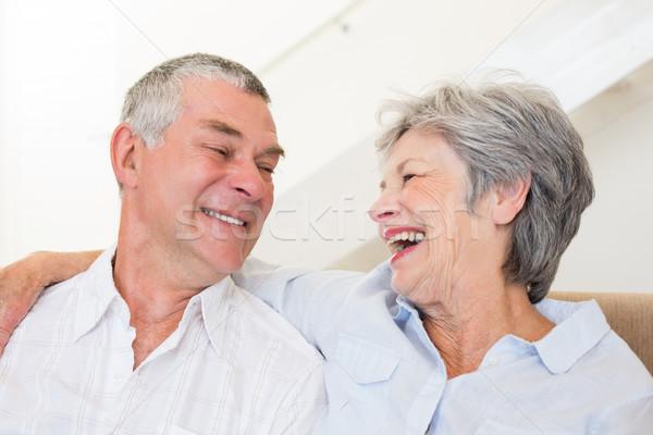 Aposentados casal sessão sofá sorridente outro Foto stock © wavebreak_media