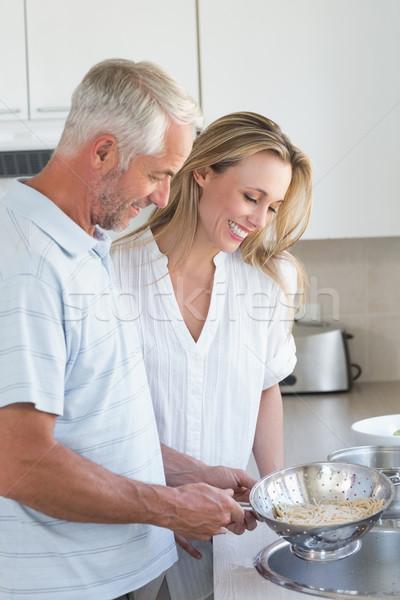 Couple draining spaghetti in colander Stock photo © wavebreak_media