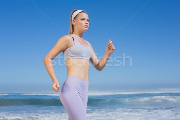 Sportos fókuszált szőke nő jogging tengerpart napos idő Stock fotó © wavebreak_media