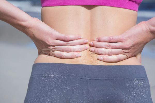 Caber mulher tocante dolorido de volta Foto stock © wavebreak_media