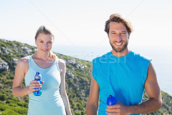 Dopasować para stałego uśmiechnięty kamery Zdjęcia stock © wavebreak_media