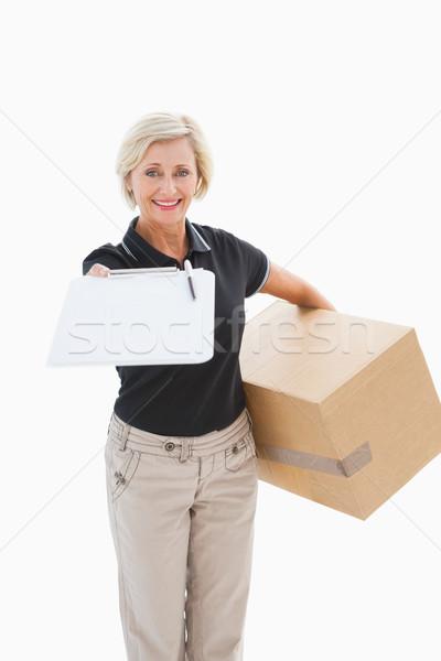 Gelukkig levering vrouw naar handtekening witte Stockfoto © wavebreak_media